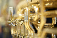 Tuba with valves and tubes close-up. A shiny tuba with valves and tubes close-up with thin depth of field Royalty Free Stock Photography