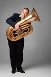 Tubaist. Young man playing the tuba Stock Image