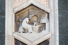Tubalcain, Florence Cathedral. Tubalcain by Nino Pisano, 1334-36., Relief on Giotto Campanile of Cattedrale di Santa Maria del Fiore Cathedral of Saint Mary of royalty free stock images