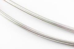 Tubatura dell'acqua elastica della fibra del metallo con i connettori Fotografia Stock