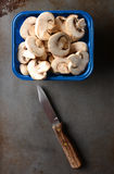 Tubb of Sliced Mushrooms With Knife Stock Photo