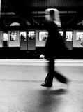 The Tube. A black and white image of a woman moving in the London underground (the Tube Royalty Free Stock Image