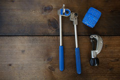 Tube bender or pipe bender tools on wooden background Stock Images