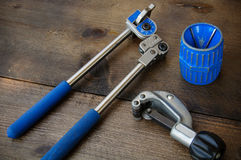 Tube bender or pipe bender tools on wooden background Royalty Free Stock Images