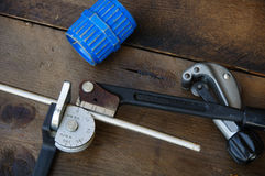 Tube bender or pipe bender tools on wooden background Stock Image