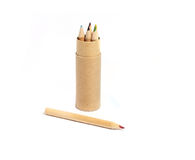 Tube with colored pencils and cover on white Stock Photography