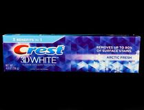Tube of Crest 3D White Toothpaste. On a black backdrop Royalty Free Stock Photo