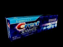 Tube of Crest 3D White Toothpaste. On a black backdrop Royalty Free Stock Image