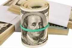 Tube des dollars avec la bande élastique Photos libres de droits
