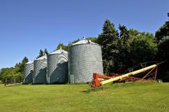 Tube elevator and grain bins in a small town Royalty Free Stock Image