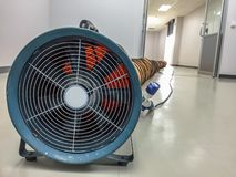 Tube Fan with confined space, Portable Ventilation Fans and Exhaust Fans from exit door at factory.  stock photos