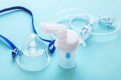 Tube mask nebulizer and tubular transparent cable royalty free stock photo
