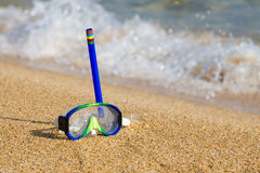 Tube and mask for a scuba diving on seacoast. Royalty Free Stock Photography