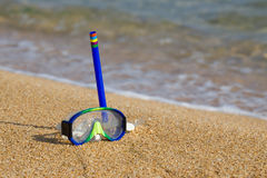 Tube and mask for a scuba diving on seacoast. Royalty Free Stock Image