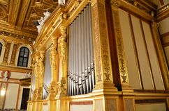 Tube organ with golden decorations Royalty Free Stock Photography