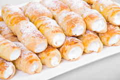 Tube of pastry filled with snow Royalty Free Stock Photos