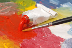 Tube of red paint. With a brush Royalty Free Stock Photo