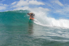 Tube ride. A surfer getting in a small tube in beautiful Hawaii Royalty Free Stock Photo