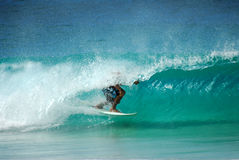 Tube ride. A surfer getting a nice tube ride in beautiful hawaii water Stock Photo