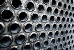 Tube sheet of the heat exchanger for maintenance, the water heater in the boiler as background. Manufacturing in Thailand stock image