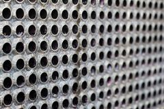 Tube sheet of the heat exchanger for new febrication, the water heater in the boiler as background. Manufacturing in Thailand stock photography