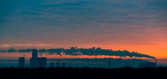 Tube with smoke on winter sunset moscow Stock Photography