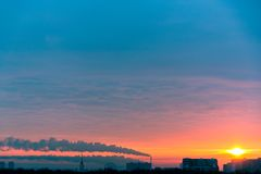Tube with smoke on winter sunset moscow Royalty Free Stock Image
