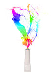 Tube spraying colored paint Stock Photography