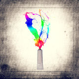 Tube spraying colored paint Royalty Free Stock Photography