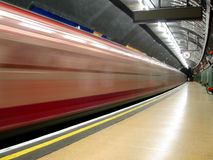 Tube Station. Empty station with a train in movement Royalty Free Stock Photos