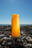 Tube with sun protection on beach Stock Photos