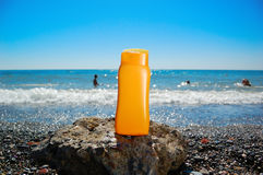 Tube with sun protection on beach Stock Photography