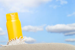 Tube with sun protection on beach Royalty Free Stock Photo