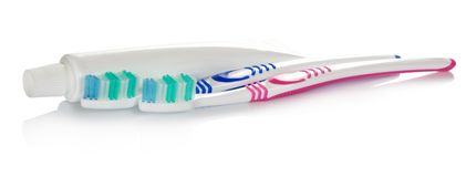 The tube of toothpaste and toothbrush Royalty Free Stock Image