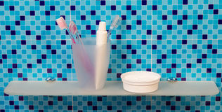 Tube of toothpaste and toothbrushes Stock Images