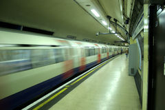 Tube train. Pulling out of the station stock photos
