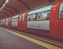 Tube train at platform in London Stock Photography