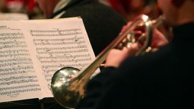Tube trumpet music instrument, playing note sheet, classics. Stock footage stock video footage