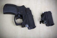 Tubeless doubly charged traumatic pistol and holder. Image with Royalty Free Stock Image