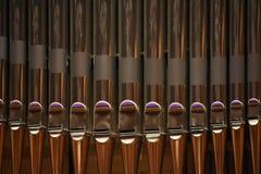 Tubería de un órgano musical delicado Imágenes de archivo libres de regalías