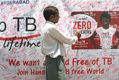 Tuberculosis awareness campaign. People signing on the banner during Tuberculosis awareness campaign on June 05,2012 in Secunderabad,Ap,Ind ia royalty free stock photos