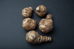 Tubers for breastfeeding or Jerusalem artichoke or Jerusalem artichoke Helianthus tuberosus isolated on a black background stock photo