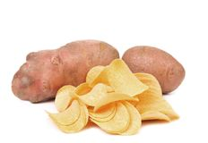 Tubers of potato and chips. Royalty Free Stock Images