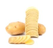 Tubers of potato and stack chips Royalty Free Stock Photography