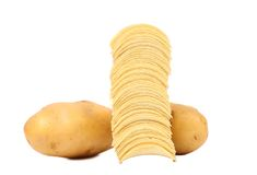 Tubers of potato and stack chips. Royalty Free Stock Photography