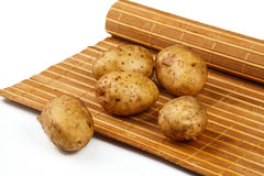 Tubers of potatoes on the mat Stock Images