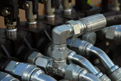 Tubes. Hoses and tubes of Crawler tractor Stock Images