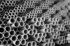 Tubes. Of various sizes stacked closely next to one another Royalty Free Stock Images