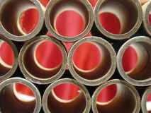 Tubes of cardboard with red background royalty free stock photography