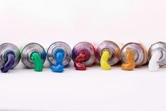 Tubes colorés de peinture Photo libre de droits